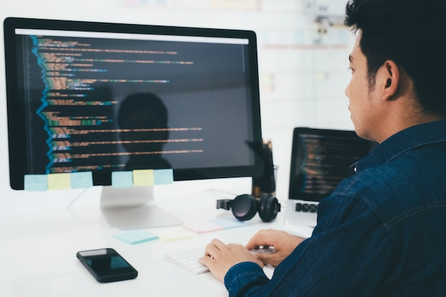 Programmers and developer teams are coding and developing software