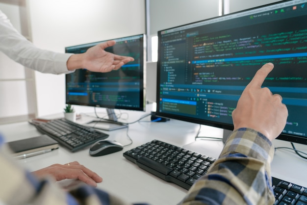 Programmers developing codes on their computers Premium Photo