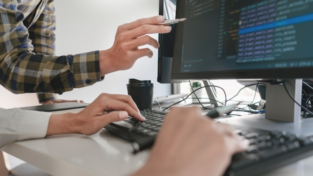 Programmers developing codes on their computers
