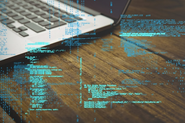 Programming code with laptop background Free Photo