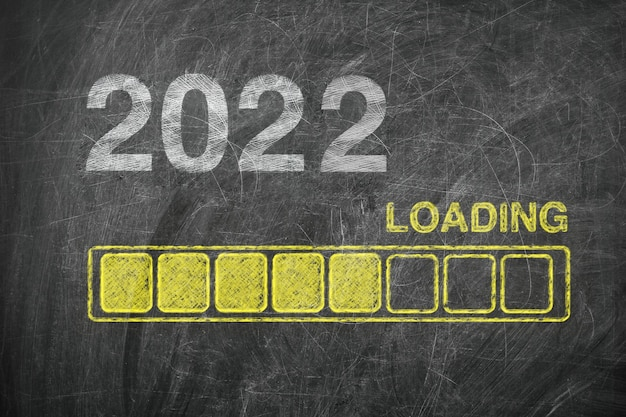 Progress bar showing loading of 2022 new year on chalkboard extreme closeup