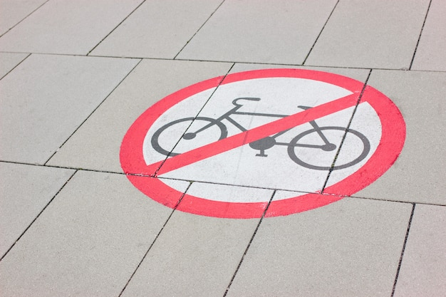 Prohibition sign for cyclists drawn on the road.