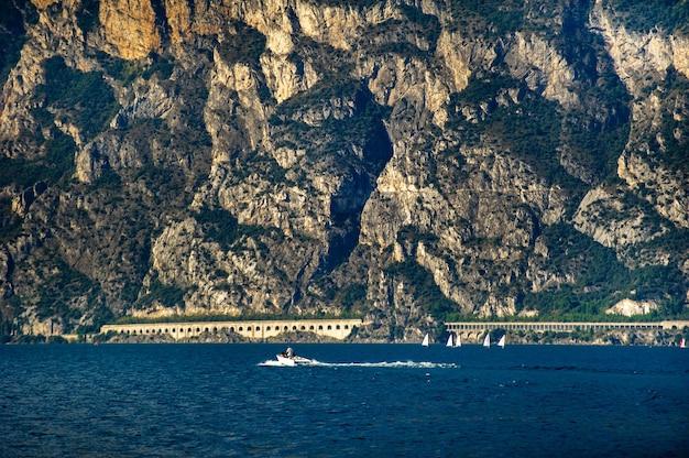 The promenade on lake garda and the alps.italy.tuscany.