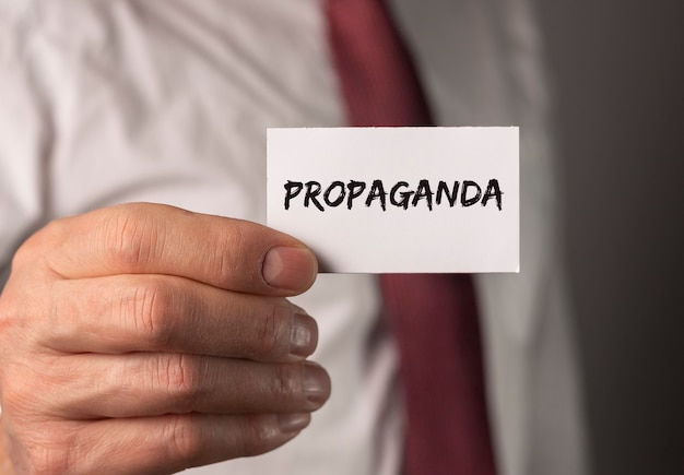 Propaganda word on paper manipulation and brainwash campaign by media concept