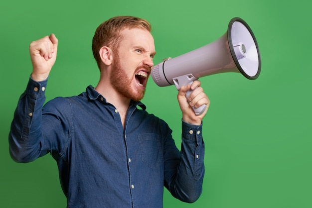 Propagandist shouting in loudspeake