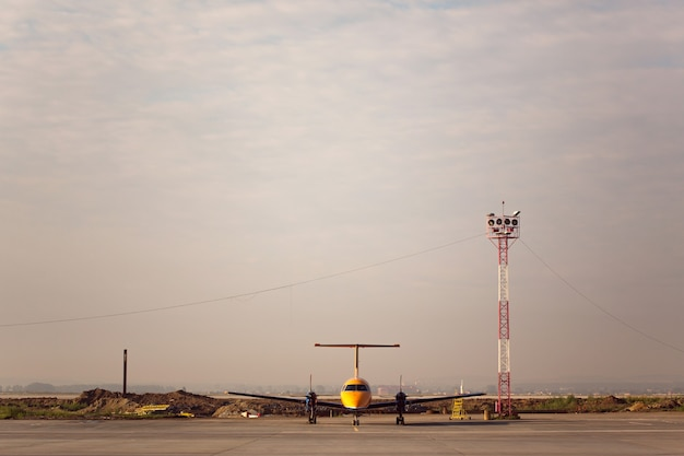 Propeller aircraft standind in airport ready for flight