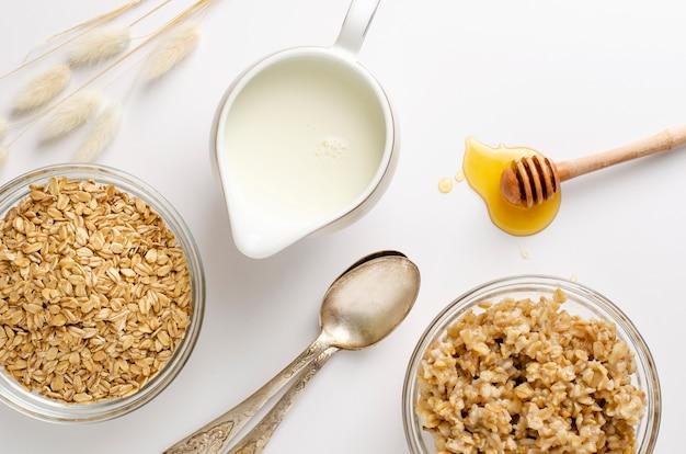 Proper nutrition menu for breakfast with atmeal porridge, milk and honey