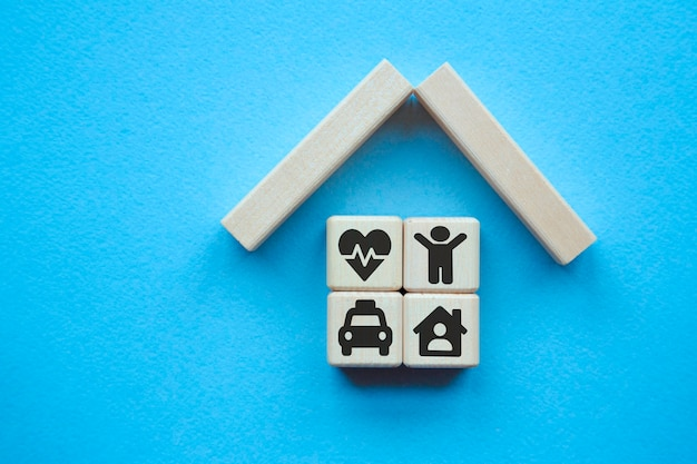 Property insurance concept. small toy house .concepts for health care and medical