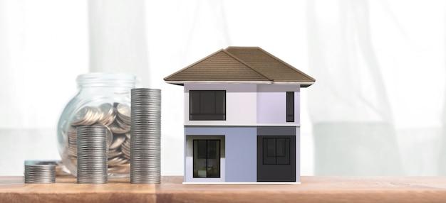 부동산 투자 및 주택 담보 금융 개념 돈 동전 스택입니다. 비즈니스 홈