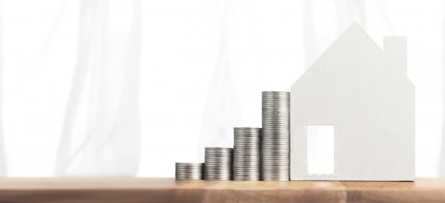 Property investment and house mortgage financial concept money coin stack. business home