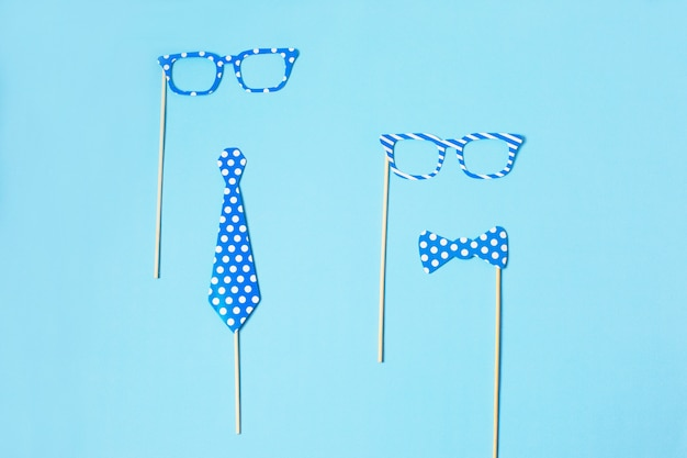 Props for party. carnival accessories set. paper tie and funny glasses on wooden sticks