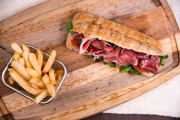 Prosciutto chapata sandwich with french fries - mexican food