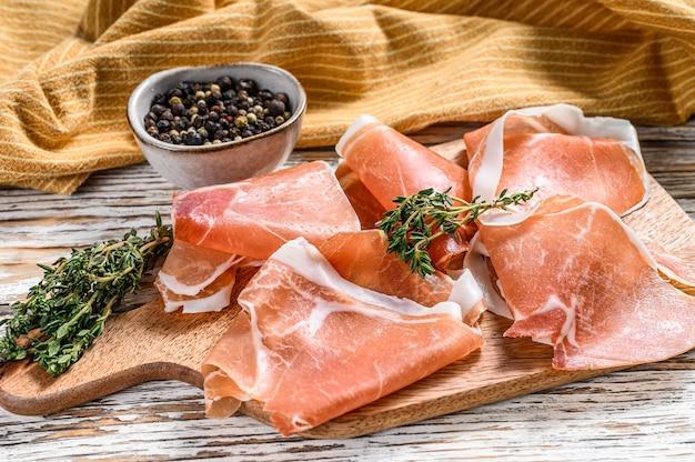 Prosciutto crudo on a cutting board, cured ham