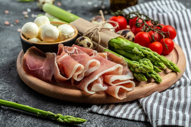 Prosciutto with mozzarella cheese and cherry tomatoes