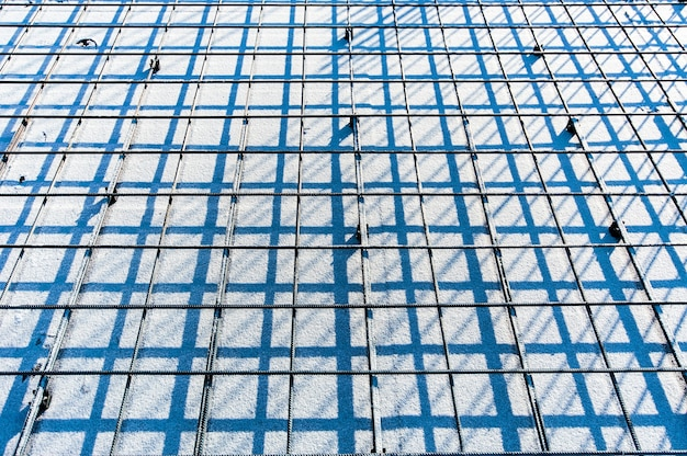 The prospect of reinforced metal mesh on a construction site in winter