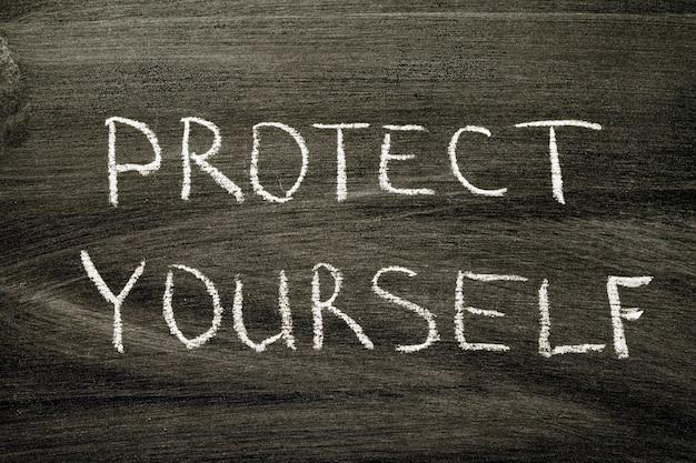 학교 칠판에 손으로 쓴 문구를 보호하십시오