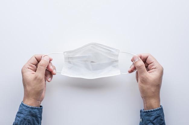 Защитите себя маской от вспышки коронавируса