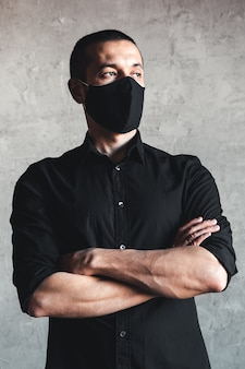 Protection against contagious disease, coronavirus. man wearing hygienic mask to prevent infection