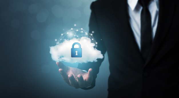 Protection cloud computing network security computer and safe your data concept. businessman holding shield protect icon