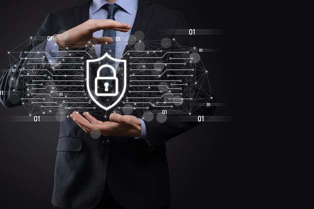Protection network security computer and safe your data concept, businessman holding shield protect icon. lock symbol, concept about security, cybersecurity and protection against dangers