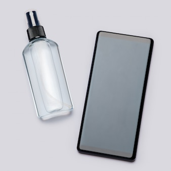 Protection or sanitation against viruses or germs - mobile phone cleaning or disinfection with sanitizer antiseptic spray