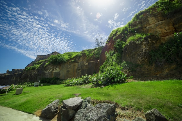 Protection wall of historic puerto rico city with beautiful clouds in summer