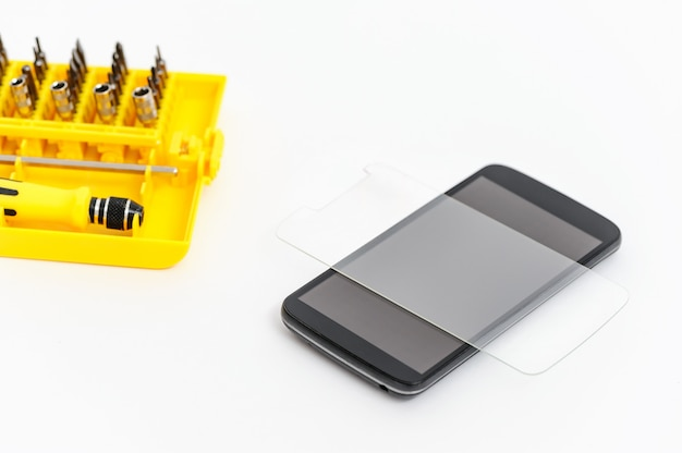 Protective glass and a smartphone.