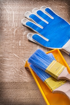 Protective gloves paint brushes tray construction concept