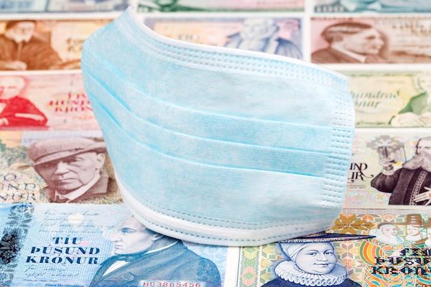 Protective mask on icelandic money