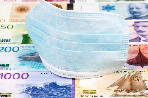 Protective mask on norwegian money