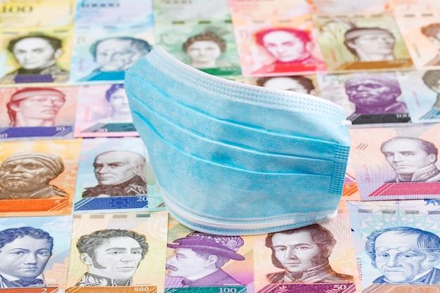 Protective mask on venezuelan money