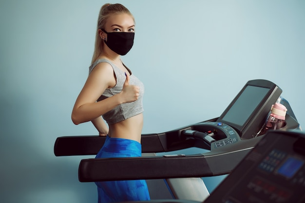 Protective masks against virus infection. training during quarantine in the gym. coronavirus (covid-19) protection concept