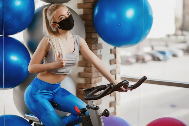 Protective masks against virus infection. training during quarantine in the gym. coronavirus (covid-19) protection concept.
