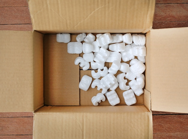 Protective white packaging peanuts that provides padding for the object being shipped