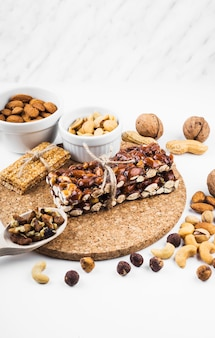Protein bar with dried fruits on white backdrop