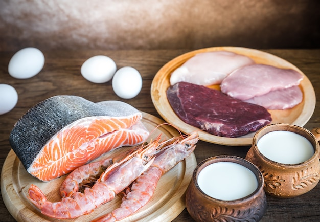 Protein diet: raw products on the wooden surface