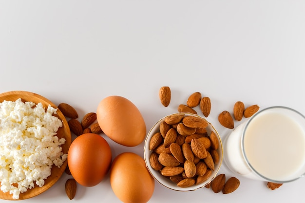 Protein food on a white background  cottage cheese eggs nuts