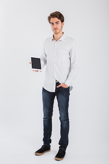 Proud businessman with tablet