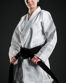 Proud karate fighter holding black belt