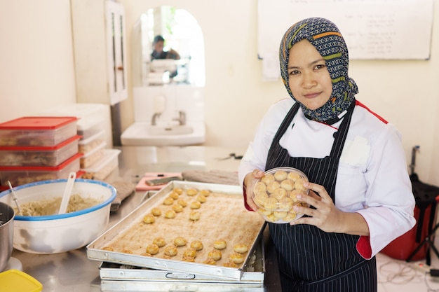 Proud muslim woman homemade bakery