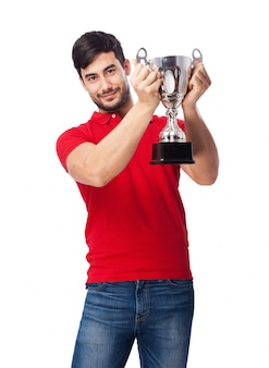 Proud teen holding up the silver cup