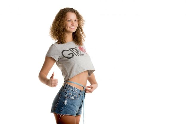 Proud woman measuring her waist