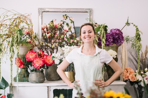 Proud young worker of floral shop