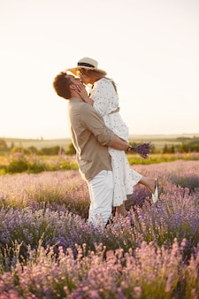 Provence couple relaxing in lavender field. lady in a white dress.