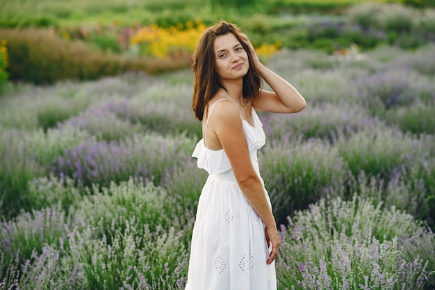 Provence woman relaxing in lavender field. lady in a white dress. girl with bag.