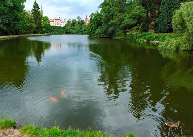 Pruhonice castle park summer view and big golden fish in lake.  prague, czech republic.