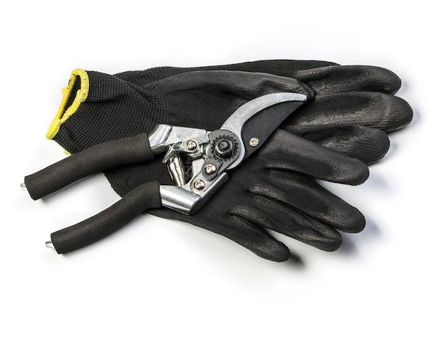 Pruner on garden gloves isolated on white