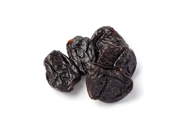 Prunes isolated on white