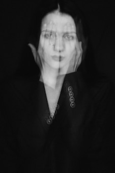 Psychedelic portrait of a woman with hands closed face