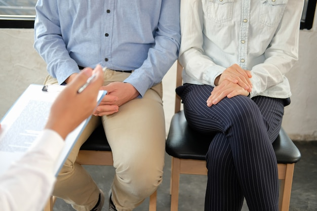 Psychiatrist giving relationship advice to couple